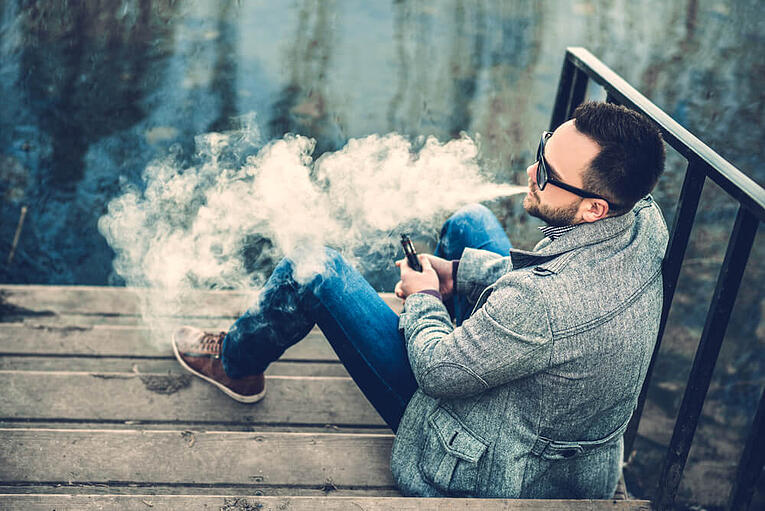 fashionable guy vaping